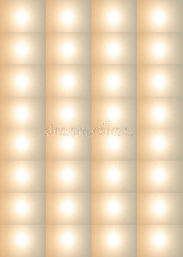 DIFFUSED SUN IN A REPEAT PATTERN. Image of a white light repeated on a soft gold coloured background royalty free stock images