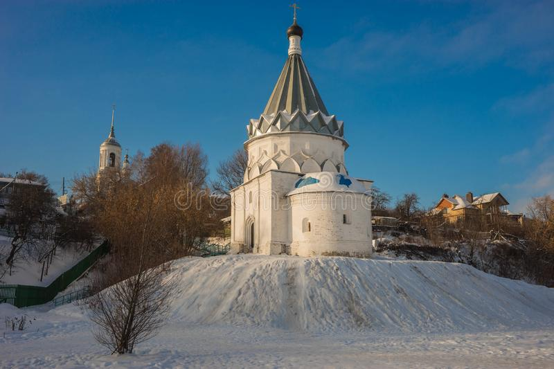 White stone church on banks of Volga in Murom. Image of white stone church on banks of Volga in Murom stock photography