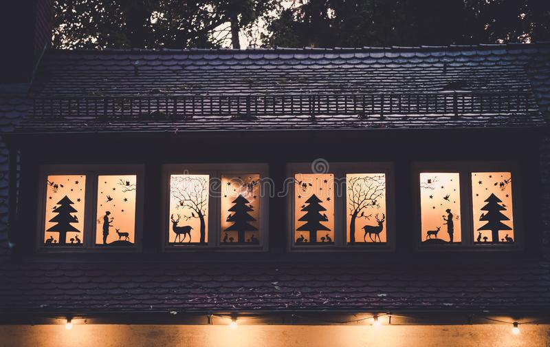 Image of window decoration with forrest fairy tale silhouettes royalty free stock photography