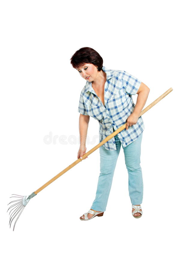 Image of woman farmer with rakes in hands royalty free stock photos