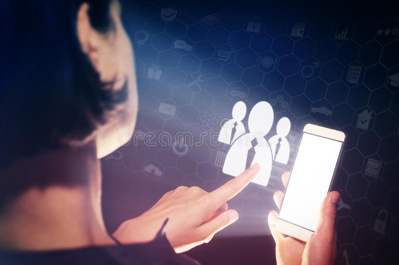 Business recruitment or hiring photo concept. Image of a woman with a smartphone in her hands. She is pressing on the candidates icon. Business recruitment or stock photo
