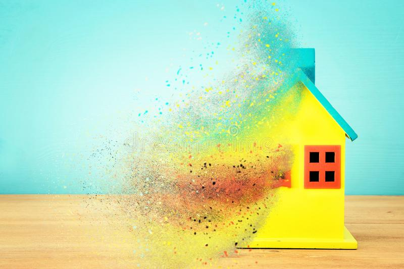 Image of wooden colorful house model. Real estate and uncertainty concept. stock image