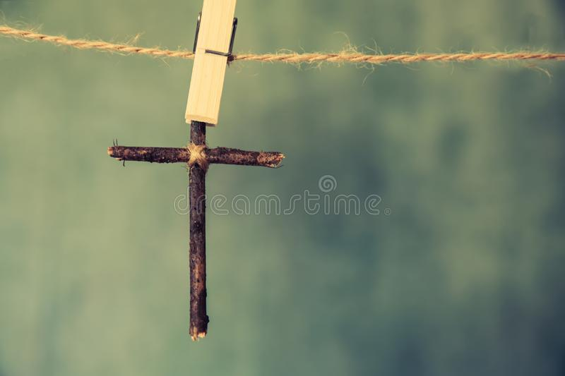 Image of wooden cross on blue retro background. royalty free stock photography
