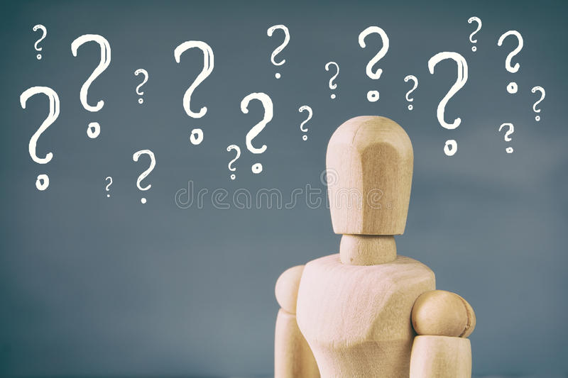 image of wooden dummy with may question marks stock images