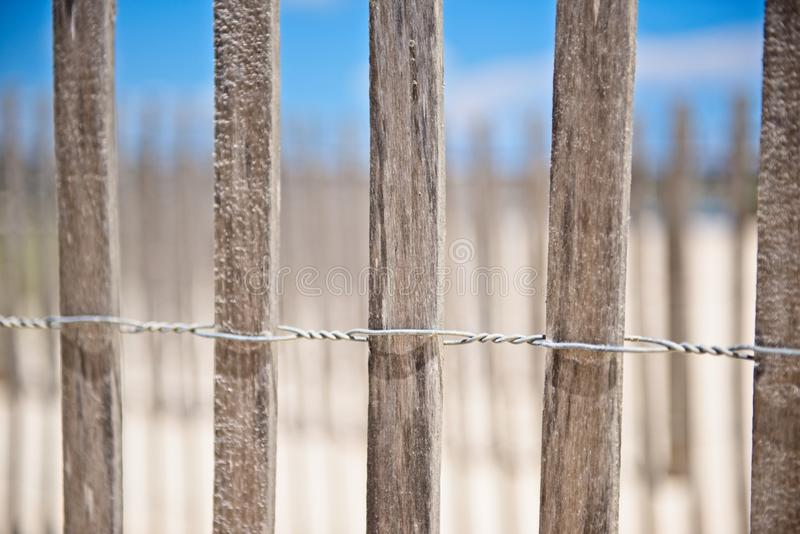 A wooden fence wrapped in wire at the beach to prevent erosion royalty free stock photography