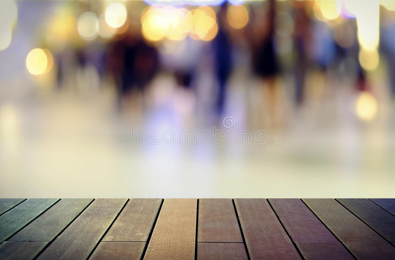 Image of wooden table in front of abstract blurred background. Image of wooden table in front of abstract blurred royalty free stock image