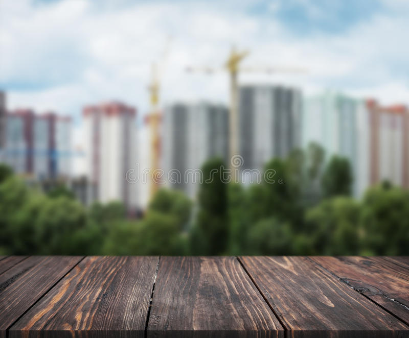 Image of wooden table in front of abstract blurred background of city landscape. can be used for display or montage your products. stock photography