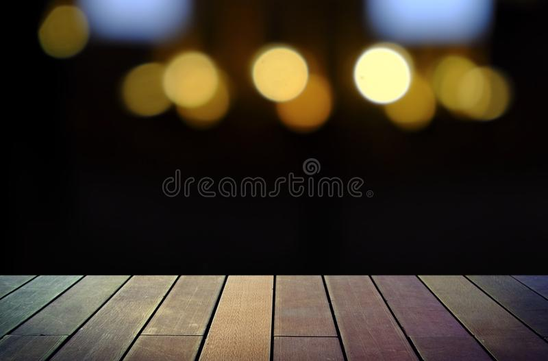 Image of wooden table in front of abstract blurred background stock photos