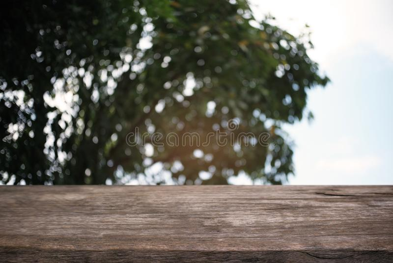 image of wooden table in front of abstract blurred background of royalty free stock images