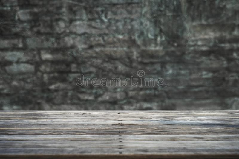 Image of wooden table in front of abstract blurred background stock photography