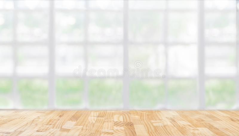 Image of wooden table in front of abstract blurred restaurant li stock images