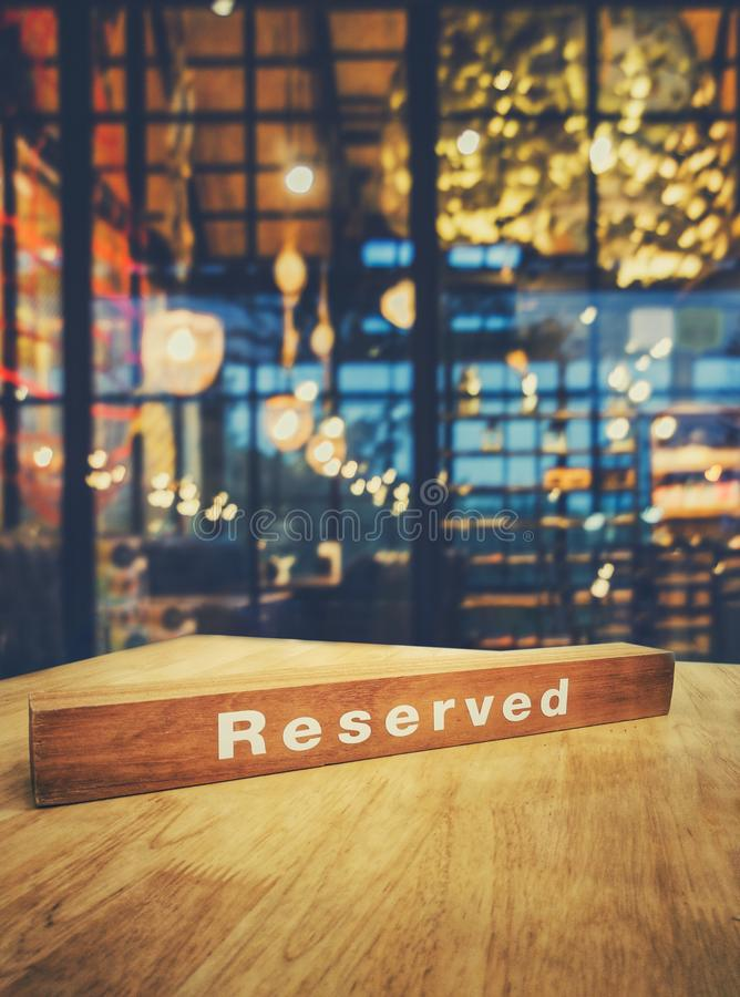Image of wooden table in front of abstract blurred restaurant li royalty free stock photography