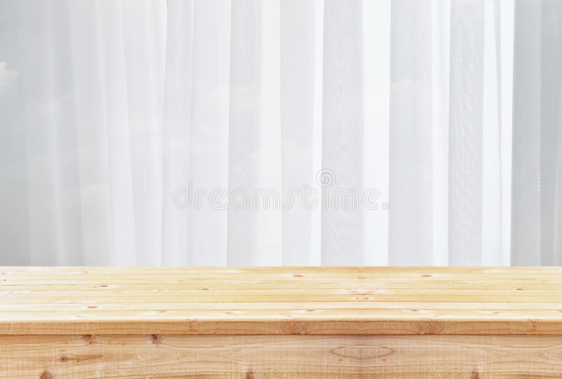image of wooden table in front of blurred window light royalty free stock image