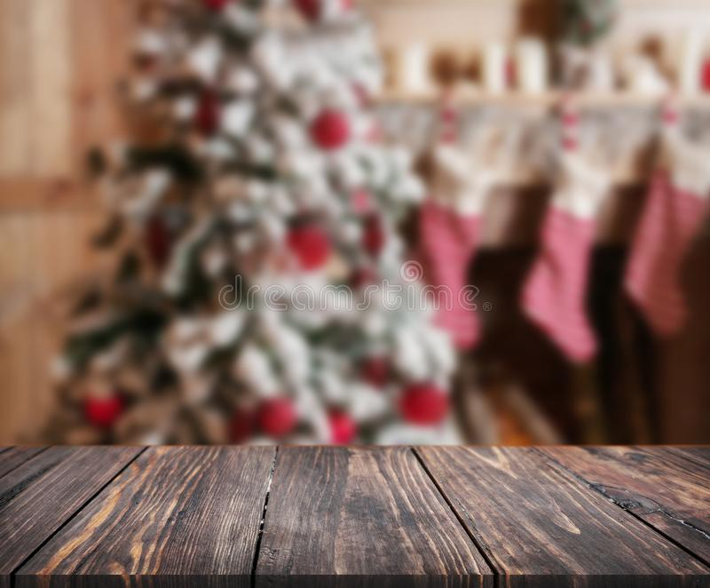Image of wooden table in front of christmas blurred background o royalty free stock image