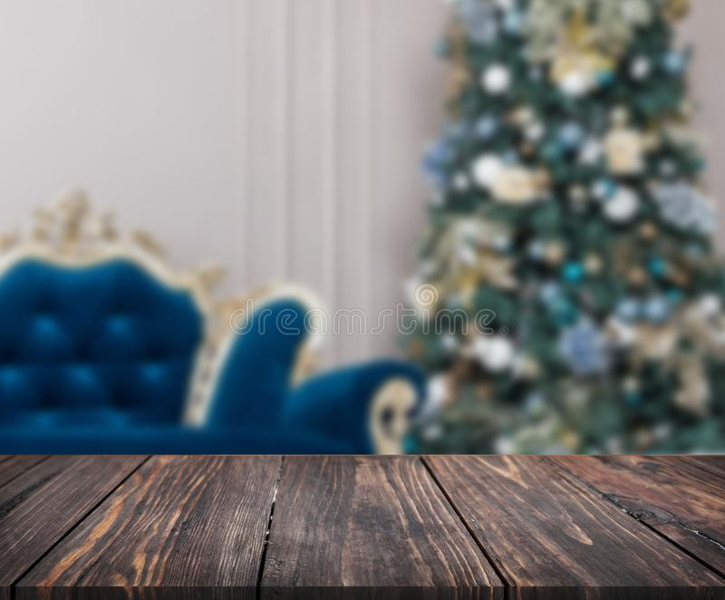 Image of wooden table in front of christmas blurred background o stock image