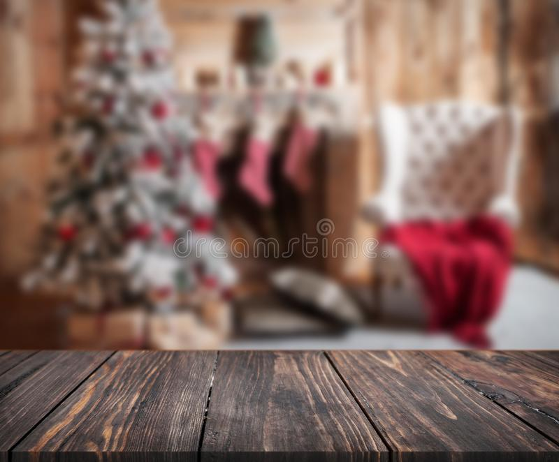Image of wooden table in front of christmas blurred background o stock images