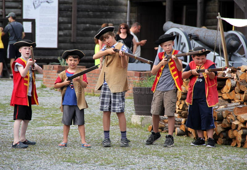 Image of young boys joining The King's Army activity,Fort William Henry,Lake George,New York,2015. Image of young children that have gone through part of guided royalty free stock image