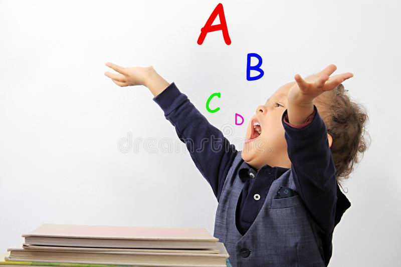 Young child learning ABC royalty free stock photos