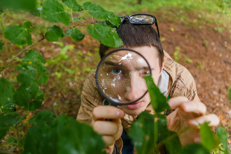 Image of young environmentalist with magnifying glass royalty free stock photos