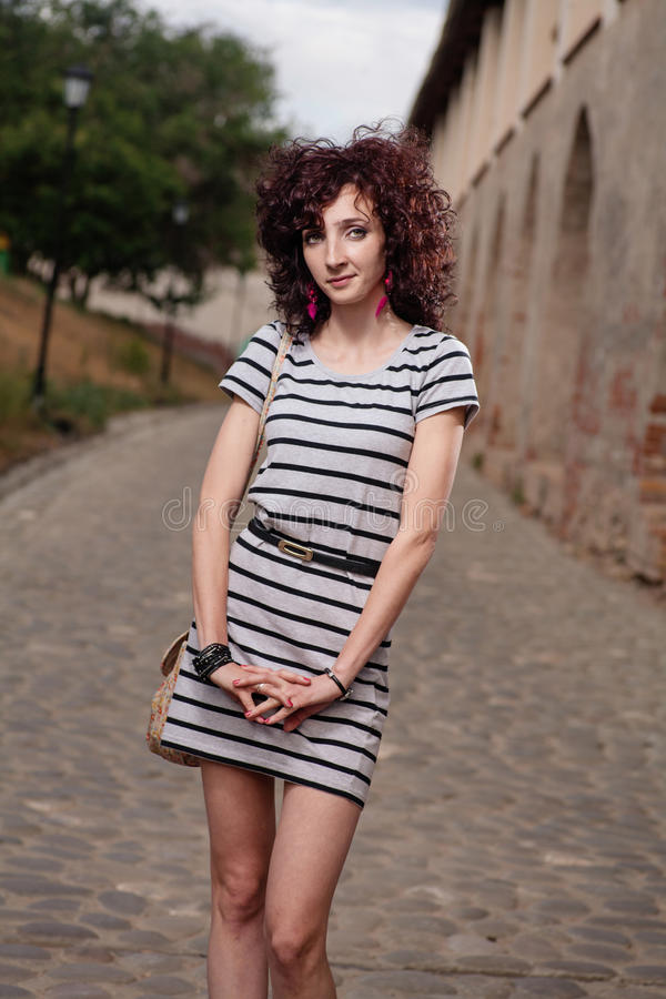 Image of young red haired woman with curls . Beautiful Brunette Girl. Healthy red hair stock photo