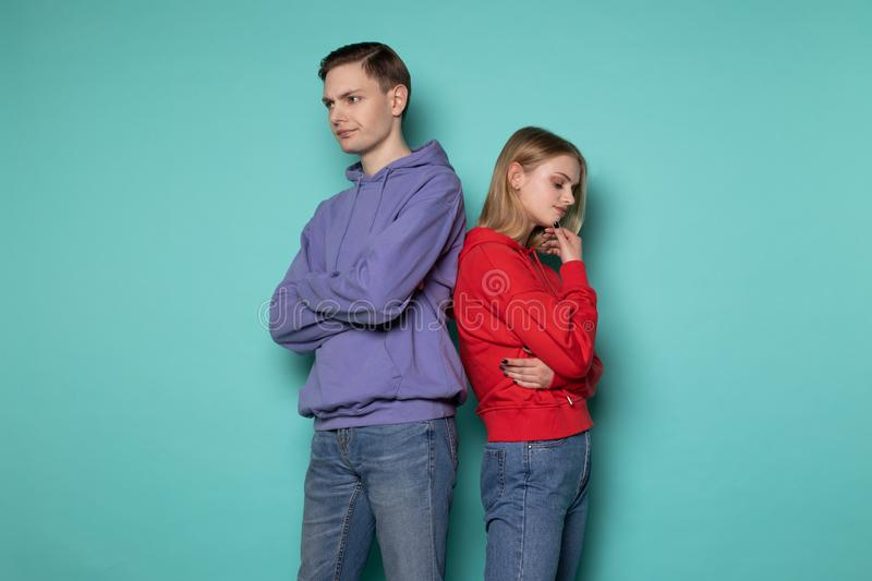 Image of young seriously people man and woman in casual clothes stock photography
