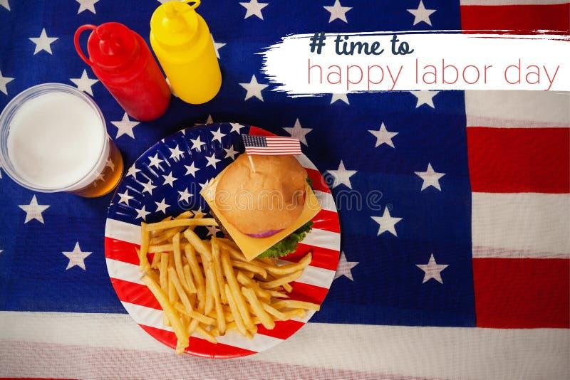Imagem composta da imagem composta digital do tempo ao texto feliz do Dia do Trabalhador imagens de stock