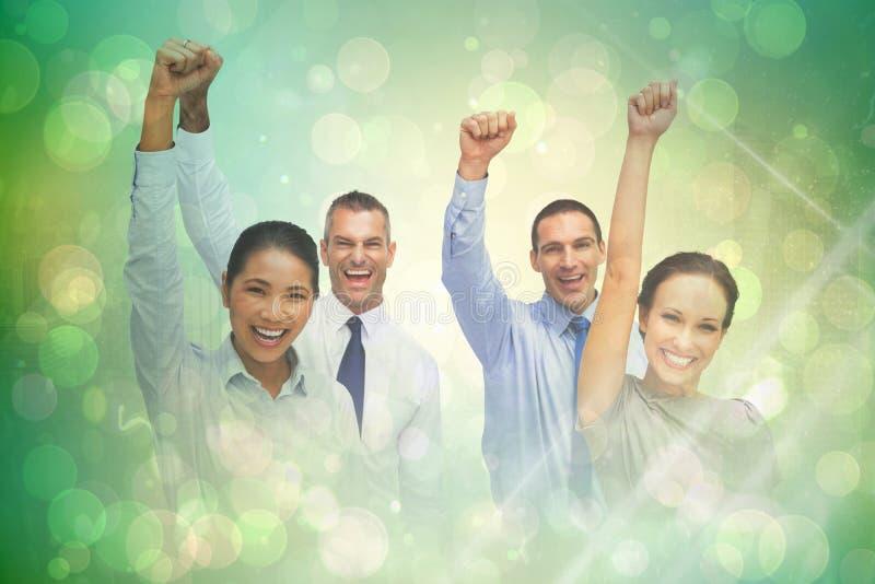 Imagem composta da equipe alegre do trabalho que levanta com mãos acima imagens de stock royalty free