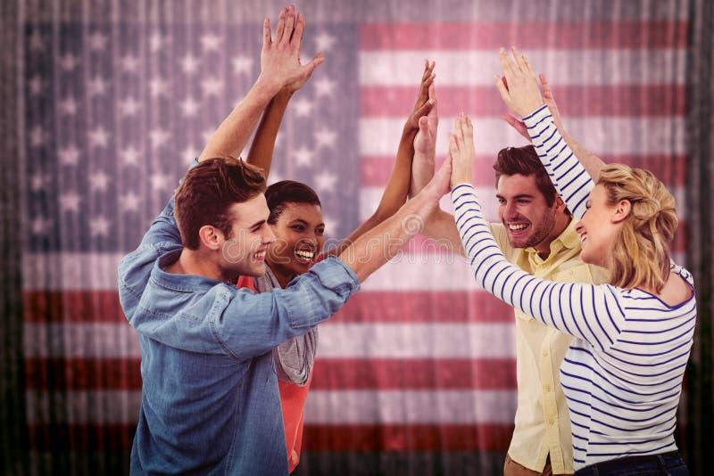Imagem composta da equipe criativa feliz que dá pífanos altos entre si fotos de stock royalty free