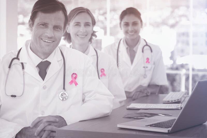 Imagem composta da fita da conscientização do câncer da mama imagem de stock