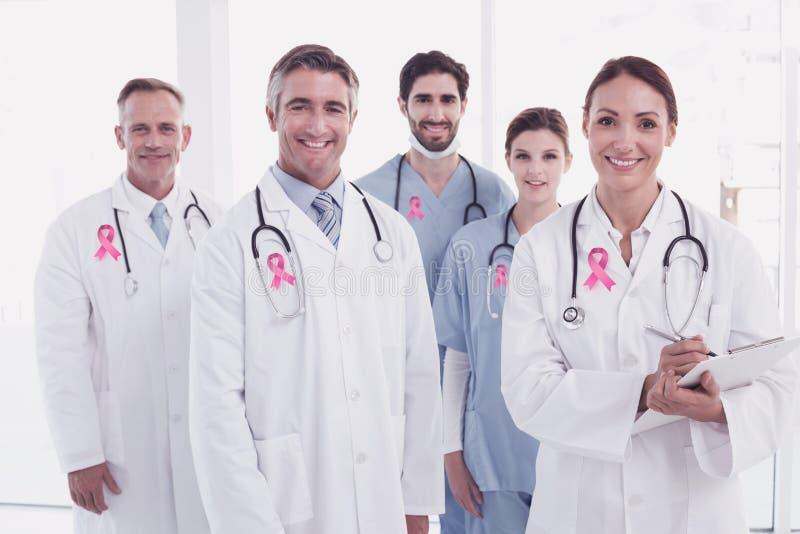 Imagem composta da fita da conscientização do câncer da mama imagens de stock