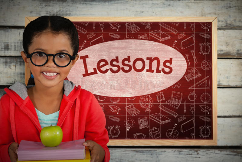 Imagem composta da menina feliz que guarda livros e maçã imagens de stock royalty free