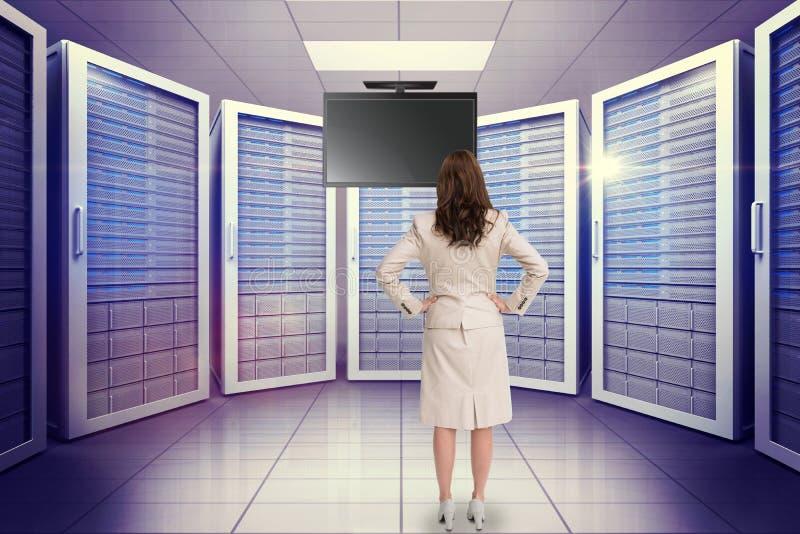 Imagem composta da mulher de negócios que está de volta à câmera fotos de stock