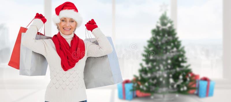 Imagem composta da mulher festiva que guarda sacos de compras foto de stock royalty free