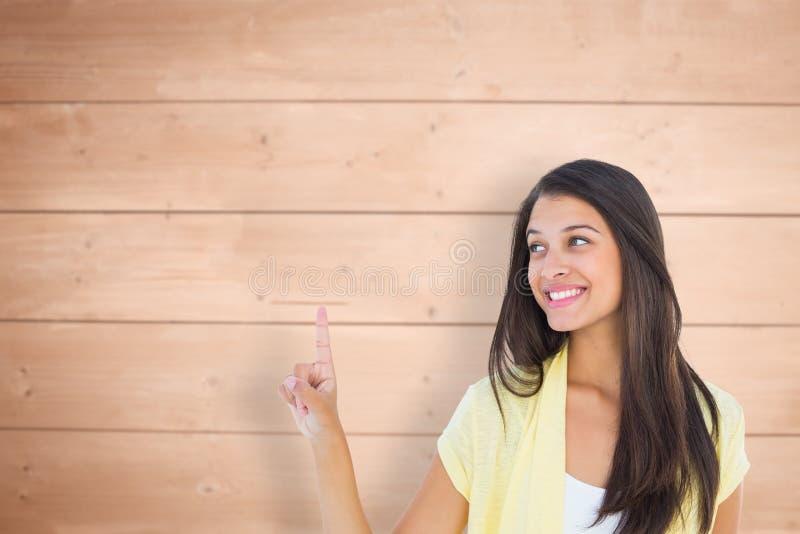 Imagem composta da mulher ocasional feliz que aponta acima foto de stock