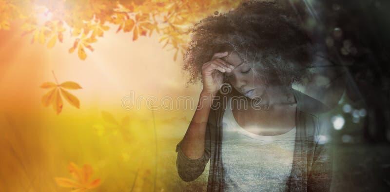 Imagem composta da mulher triste que guarda sua testa com sua mão fotos de stock royalty free