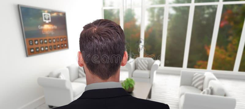 Imagem composta da opinião traseira o homem de negócios na posição do terno fotografia de stock royalty free