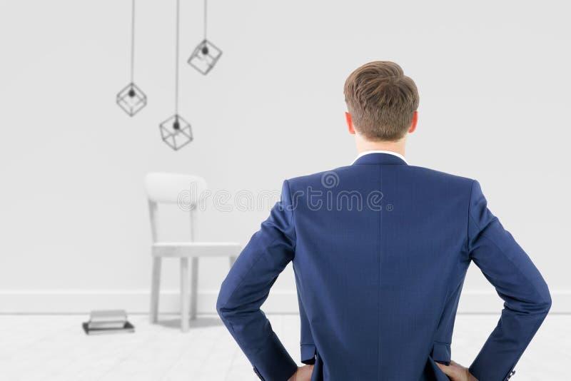 Imagem composta da opinião traseira o homem de negócios que está com mãos no wiast imagens de stock