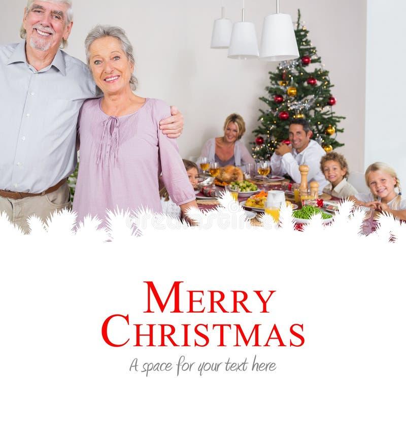 Imagem composta das avós que estão pela tabela de jantar fotografia de stock