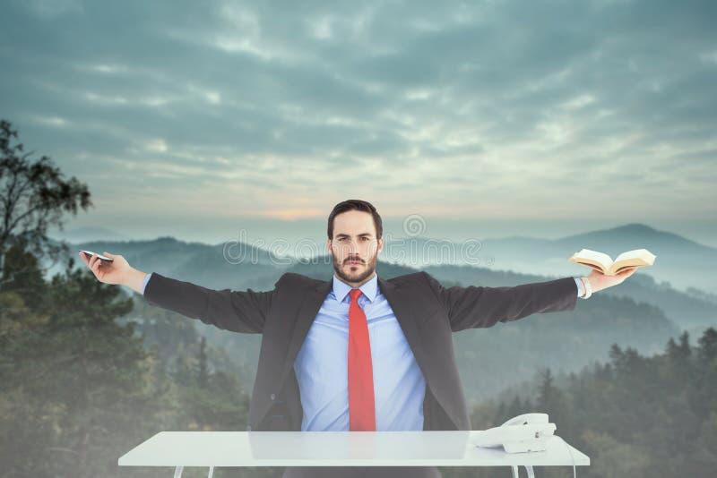 Imagem composta de homem de negócios unsmiling que senta-se com os braços estendido fotografia de stock