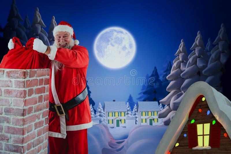Imagem composta de Papai Noel que coloca o saco do Natal na chaminé fotografia de stock royalty free