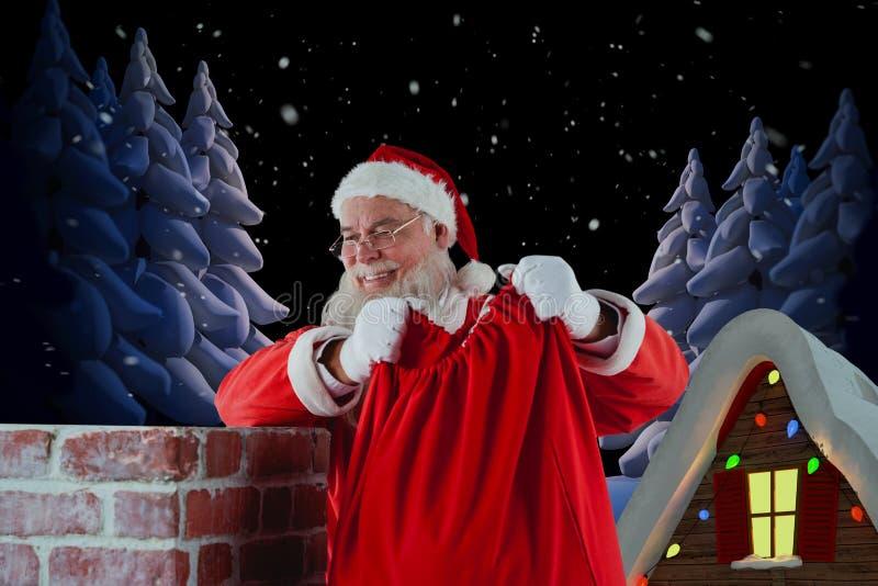 Imagem composta de Papai Noel que guarda o saco do presente na chaminé fotografia de stock