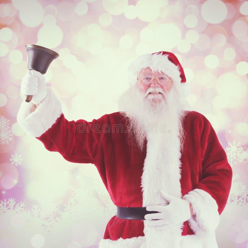 A imagem composta de Papai Noel soa seu sino fotos de stock royalty free