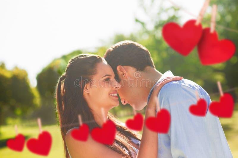 Imagem composta de pares loving e felizes no parque ilustração stock