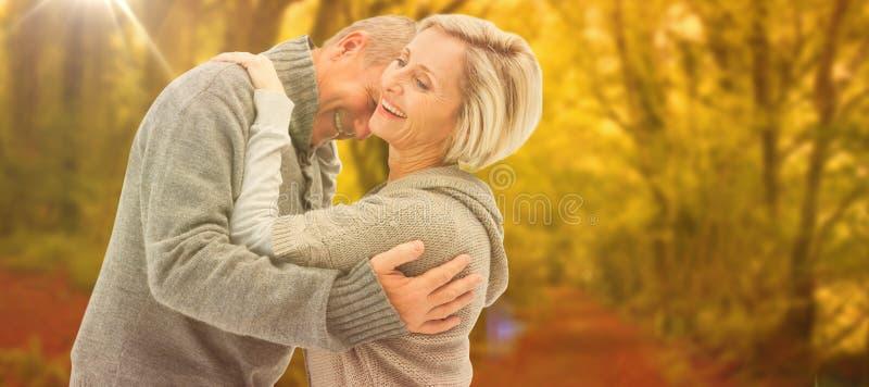 A imagem composta de pares maduros felizes no inverno veste-se fotografia de stock royalty free