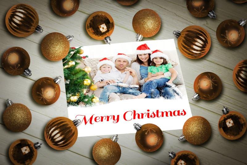 Imagem composta de quinquilharias do Natal na tabela fotografia de stock