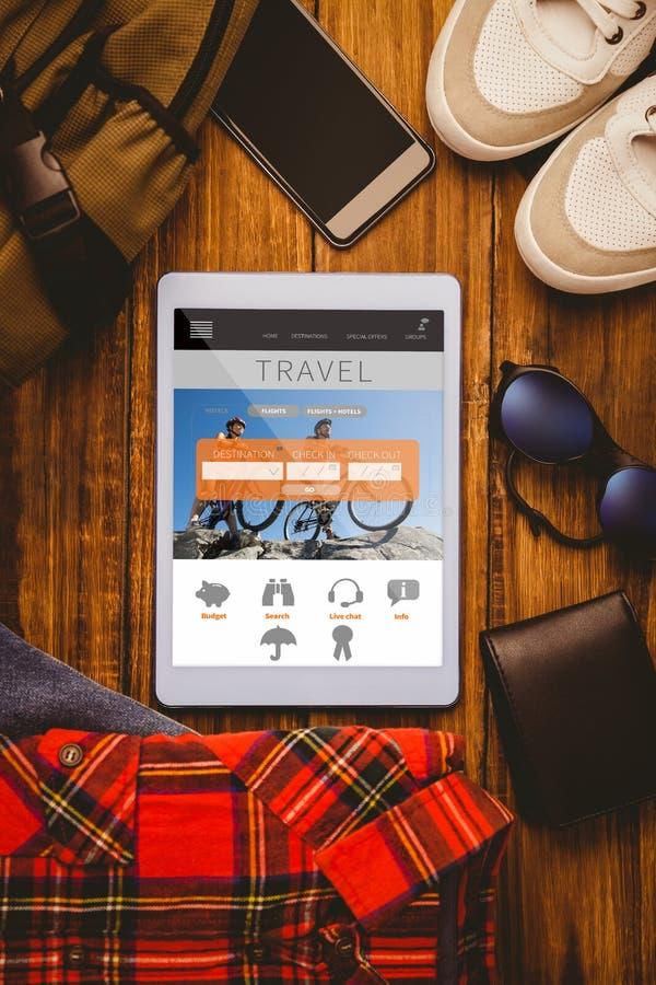 A imagem composta do brim da camisa da tabuleta calça a carteira e o saco do smartphone fotografia de stock royalty free