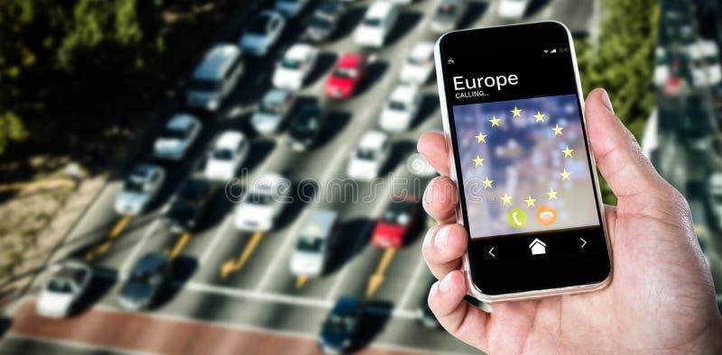 Imagem composta do close-up da mão que guarda o móbil foto de stock