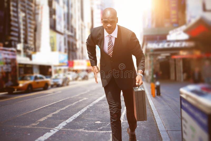Imagem composta do corredor do homem de negócios imagem de stock royalty free