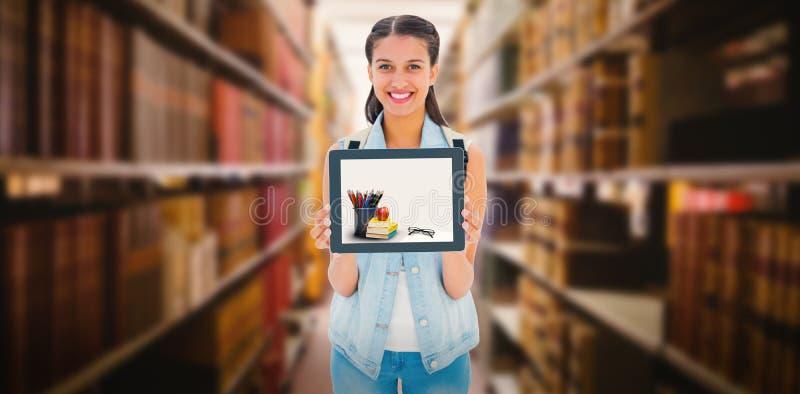 Imagem composta do estudante bonito que mostra seu PC da tabuleta imagens de stock royalty free
