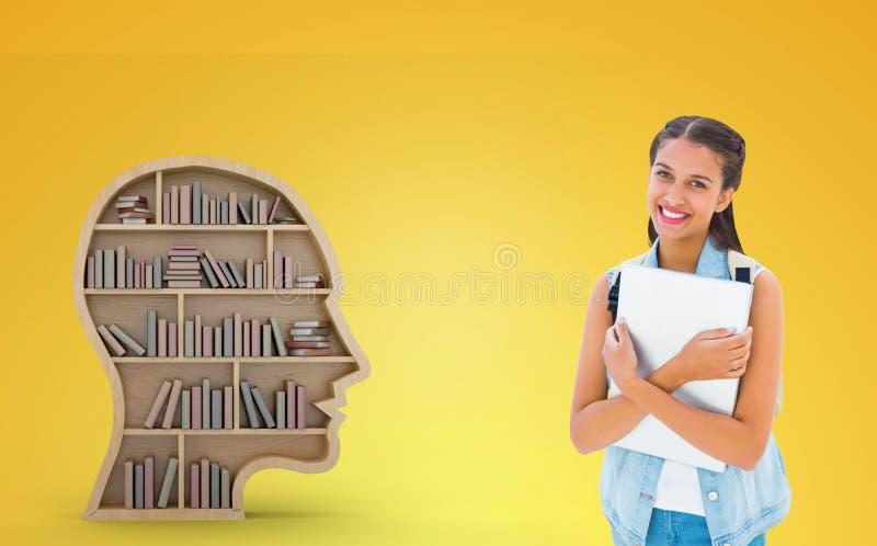 Imagem composta do estudante que guarda o portátil fotos de stock